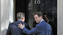 British Prime Minister David Cameron greets Deputy Prime Minister Nick Clegg at 10 Downing Street on Wed., May 12. (Matt Cardy/2010 Getty Images)