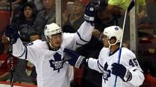 Toronto Maple Leafs forwards Tyler Bozak, left, and Viktor Stalberg celebrate after Stalberg scored against Detroit Red Wings during the first period of their preseason game in Detroit. (REBECCA COOK)