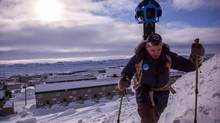 Mapping expert Chris Kalluk hikes above Iqaluit with a Google camera strapped to his back. (Google)