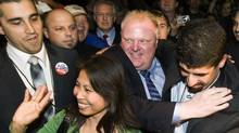 Toronto mayor-elect Rob Ford, centre, is hugged by a mob of supporters as he makes his way into speak to supporters in Toronto on Monday, October 25, 2010. (Nathan Denette/The Canadian Press/Nathan Denette/The Canadian Press)