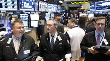 Traders work on the floor at the New York Stock Exchange, June 13, 2013. (BRENDAN MCDERMID/REUTERS)