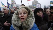 People sing the Ukrainian national anthem during an anti-government rally in Kiev Feb. 9. (DAVID MDZINARISHVILI/REUTERS)