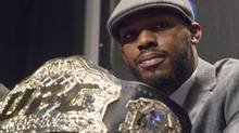 The UFC Light Heavyweight champion belt is seen in front of UFC fighter Jon Jones as he pauses while speaking to members of the media during a press conference  Jon Jones in Toronto on Thursday, December 8, 2011. (The Canadian Press)