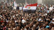 A man holds an Egyptian flag during a rally at Tahrir Square, in Cairo Feb. 25, 2011. (Peter Andrews/Reuters/Peter Andrews/Reuters)