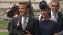 In this image taken from video, England's soccer star David Beckham, left and his wife Victoria arrive at Westminster Abbey for the Royal Wedding in London. (AP)