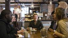 Ontario Premier Kathleen Wynne, centre, talks to selected guests at a Toronto coffee shop, before making an announcement on the minimum wage in the province, on Thursday, January 30, 2014. (Chris Young/THE CANADIAN PRESS)