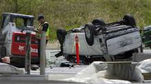Police investigate the aftermath of a fatal car crash at the intersection of 176th Street and 32nd Avenue in Surrey, B.C. on Sunday, April 28, 2013. RCMP in British Columbia say five people are dead after a serious crash near the U.S border. (ERIC DREGER/THE CANADIANS PRESS)