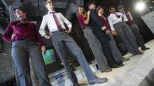 Models show off Air Canada Rouge's new uniforms in Toronto on Monday, May 27, 2013. (Kevin Van Paassen/The Globe and Mail)