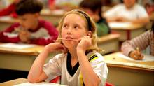 Crystal Rockwood writes her Grade 3 province-wide test. (Derek Ruttan/Derek Ruttan/The Canadian Press)