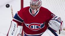Montreal Canadiens' goaltender Carey Price makes a save against the Buffalo Sabres during first period NHL action in Montreal, Tuesday, March 25, 2014. (Graham Hughes/THE CANADIAN PRESS)