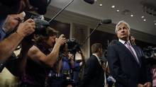 "JP Morgan Chase and Company CEO Jamie Dimon is surrounded by the media as he arrives to testify before the U.S. Senate Banking, Housing and Urban Affairs Committee hearing on ""A Breakdown in Risk Management: What Went Wrong at JPMorgan Chase?"" on Capitol Hill in Washington, on June 13. (LARRY DOWNING/REUTERS)"