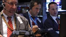 Traders work on the floor of the New York Stock Exchange, September 13, 2013 (BRENDAN MCDERMID/REUTERS)