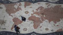 Pedestrians in Lisbon cross a square decorated with a giant world map. In recent years, Portugal has been a magnet for immigrants from its former colonies and other African nations but as Lisbon struggles to navigate the turbulent straits of the euro zone crisis, that trend has been reversed. (Rafael Marchante/Reuters/Rafael Marchante/Reuters)