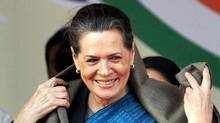 Sonia Gandhi smiles as she attends a rally in New Delhi on Nov. 29, 2011. (REUTERS)