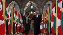 Prime Minister Stephen Harper and his Jamaican counterpart, Portia Simpson Miller. (CHRIS WATTIE/REUTERS)