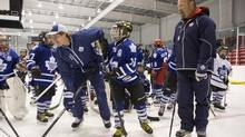 Former Maple Leafs captain Wendel Clark, right, and newly acquired forward David Clarkson show the youngsters a thing or two at the Leafs' hockey school on Thursday. (Chris Young/THE CANADIAN PRESS)