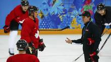 Canada's Sidney Crosby and head coach Mike Babcock (R) participate in their men's team ice hockey practice at the 2014 Sochi Winter Olympics, February 12, 2014. (MARK BLINCH/REUTERS)