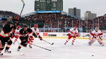 Patrick Kane #88 and Jonathan Toews #19 of the Chicago Blackhawks chase down the puck against the Detroit Red Wings during the NHL Winter Classic at Wrigley Field on January 1, 2009 in Chicago, Illinois. (Photo by Jamie Squire/Getty Images) (Jamie Squire/2009 Getty Images)