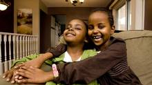 Mekfira Livingstone, right, is having fun with her adopted sister Kalkidan at their home Kelowna, B.C. on March 13, 2009. (Jeff Bassett For The Globe and Mail)