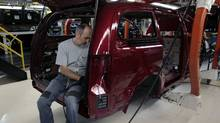 A Chrysler auto assembly worker assembles the new 2011 Dodge Grand Caravan's and Chrysler Town & Country minivans at the Windsor Assembly Plant in Windsor, Ontario January 18, 2011. (© Rebecca Cook / Reuters/Reuters)
