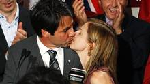 Dr. Eric Hoskins celebrates his win in the St. Paul's riding, kissing his wife. Sept. 17, 2009. (Della Rollins For The Globe and Mail/Della Rollins For The Globe and Mail)