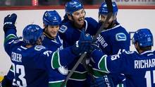 Vancouver Canucks' Alexander Edler, of Sweden, from left to right, Kevin Bieksa, Zack Kassian, Darren Archibald and Brad Richardson celebrate Kassian's goal against the Toronto Maple Leafs during second period NHL hockey action in Vancouver, B.C., on Saturday November 2, 2013. (The Canadian Press)