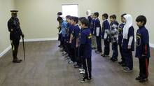 "Children at a Hamilton Islamic School take part in a RCMP ""junior police academy"" in 2011. Police officials say they are having discussions about getting Mountie detectives and, possibly, Canadian Security Intelligence Service officers, into schools in Toronto so they can reach out to students. (Kamran Bhatti)"