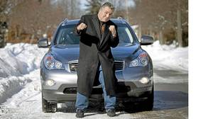 George Chuvalo and his Infiniti EX35.