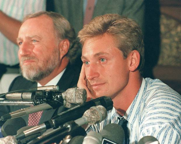 Wayne Gretzky and Edmonton Oilers' owner Peter Pocklington attend a news conference in Edmonton after Gretzky was traded to the Los Angeles Kings, Aug. 9, 1988. While the NHL's introduction of a salary cap has made it more difficult for teams to make trades, there's still a long history of wheeling and dealing.