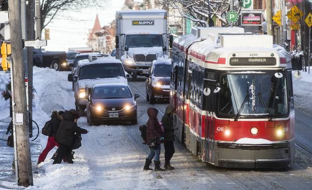 People board a TTC streetcar after a snowstorm in Toronto.