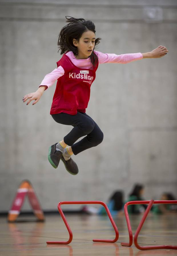Lucy Neville-Hadley, 10, a grade 6 student at Grandview Elementary School, leaps over an obstacle while participating in the KidsMove program at the Fortius Sport & Health facility in Burnaby, B.C.,