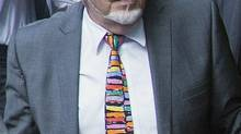 Veteran entertainer Rolf Harris was sentenced to five years and nine months in prison. (Bogdan Maran/Associated Press)