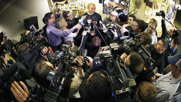 Pittsburgh Penguins' Jarome Iginla, top center, meets the media outside the Penguins locker room before an NHL hockey game against the New York Islanders in Pittsburgh Saturday, March 30, 2013. (Gene J. Puskar/AP)