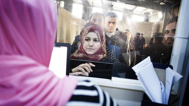 Syrian refugees line up at the UNHCR registration office in Amman, Jordan in November 2015 for an interview that would determine whether they are eligible for a second interview by Canadian authorities.