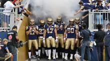 Winnipeg Blue Bombers players wait to enter the Investors Group Field prior to their CFL football game against the Montreal Alouettes in Winnipeg June 27, 2013. (Reuters)
