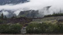 Heavy equipment can be seen working on the Kitimat Liquified Natural Gas project at Bish Cove, Douglas Channel, south of Kitimat, B.C., on Wednesday, June 27, 2012. (Robin Rowland/THE CANADIAN PRESS)