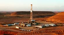 Drilling rig over the heijah feild in Yemen. (Courtesy of Nexen Inc.)