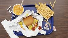 Elevated View of a Tray With Fries, a Hamburger and Lemonade (Digital Vision./Getty Images)