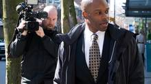 RCMP Constable Kwesi Millington leaves court during a lunch break at his perjury trial in Vancouver on March 10, 2014. (Darryl Dyck/The Canadian Press)