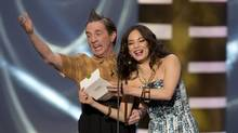 Host Martin Short, left, and Kristin Kreuk present an award at the Canadian Screen Awards in Toronto on Sunday, March 3, 2013. (Frank Gunn/THE CANADIAN PRESS)