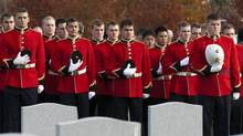 Members of the Royal Military College stand for a moment of silence as they take part in the Remembrance Day ceremony at the National Military Cemetery in Ottawa, Friday November 11, 2011. (FRED CHARTRAND/THE CANADIAN PRESS)