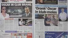 Two Johannesburg newspapers report Tuesday, July 15, 2014 on how Oscar Pistorius, right, who is accused of the murder of his girlfriend, recently visited a nightclub with a cousin and was allegedly accosted by a man, Jared Mortimer, left and center, who aggressively questioned him about his murder trial, his family said Tuesday. (Denis Farrell/AP)