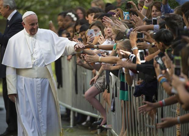 Pope Francis greets well-wishers as he leaves the Apostolic Nunciature to the United States on September 24, 2015 in Washington, DC.