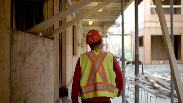A worker walks through one of the Co-op Federation's projects under construction along the Fraser River.
