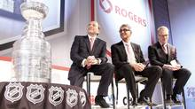 NHL commissioner Gary Bettman, left, Rogers Communications CEO Nadir Mohamed, centre, and Rogers Media president Keith Pelley during a conference announcing a 12-year national broadcast and multimedia agreement between Rogers Communications and the NHL in Toronto. (Fernando Morales/The Globe and Mail)