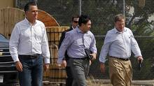 Republican presidential candidate and former Massachusetts Governor Mitt Romney walks across the tarmac with advisors Lanhee Chen (C) and Stuart Stevens (R) after a campaign rally at the airport in Pueblo, Colorado September 24, 2012. (BRIAN SNYDER/Reuters)