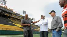 With the Hamilton Tiger-Cats set to play their final regular-season CFL game at Ivor Wynne Stadium on Saturday afternoon, several former Ticats players are in town to bear witness. On Friday, alumni including, from left to right, defensive end Joe Montford (1996-2001, 2003-04), defensive end Grover Covington (1981-91), receiver/defensive back Garney Henley (1960-75) and receiver Earl (the Pearl) Winfield (1987-97) share war stories on the field. (Glenn Lowson for The Globe and Mail)