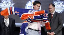 Nail Yakupov puts on his new jersey after being picked by the Edmonton Oilers in the first round of the NHL draft in Pittsburgh, Pennsylvania, June 22, 2012. (Reuters)