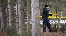 An OPP officer tapes off property belonging to Colonel Russell Williams in Tweed, Ont. (Ben Nelms for The Globe and Mail)