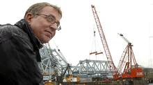 """Ross Crockford, director of the johnsonstreetbridge.org watches as a massive crane lifts a 250-tonne section of Victoria's iconic """"blue bridge"""" on to a barge below. (Diana Nethercott/Diana Nethercott)"""